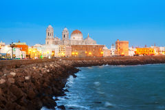 Evening view of  Cathedral and  ocean coast in Cadiz Royalty Free Stock Photos