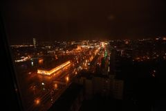 Evening view of the city from the office window royalty free stock photography
