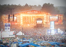 Evening view of concert on main stage and tents. Stock Photos