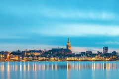Evening view of the Dutch city of Nijmegen. With the flooded river Waal in front Royalty Free Stock Photos