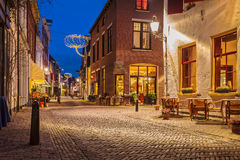 Evening view of the Dutch historic city centre of Deventer. Evening view of the famous Walstraat in the Dutch historic city centre of Deventer Stock Photography