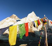 Evening view of Everest with buddhist prayer flags Royalty Free Stock Photo