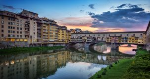 Evening view of the famous bridge Ponte Vecchio on the river Arno in Florence, Italy royalty free stock photo
