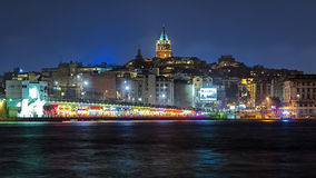 Evening view of Galata Tower and Galata Bridge in Istanbul Royalty Free Stock Images