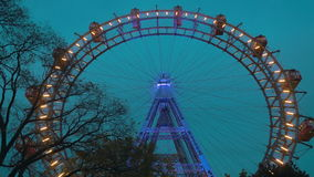 Evening view of Giant Ferris Wheel in Vienna, Austria stock footage