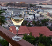 Evening view with glass of white wine Royalty Free Stock Photography