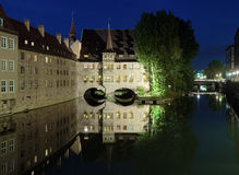Evening view of the Heilig-Geist-Spital in Nuremberg, Germany Stock Photos