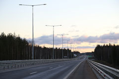 Evening view of the highway at sunset. Royalty Free Stock Photography