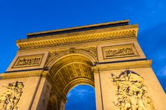 Evening view of Illuminated Arc de Triomphe in Paris. France Royalty Free Stock Photography