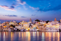 Evening view of  illuminated houses on lake Pichola in Udaipur Stock Photo
