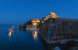 Evening view of illuminated  Old fortress and yachts, Corfu i Stock Photography