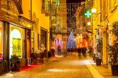 Evening view of illuminated street of Alba. Royalty Free Stock Image
