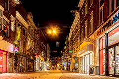 Evening view of the Koningstraat shopping street with shops and Stock Photo