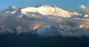 Evening view of Lenin Peak from Alay range Stock Image