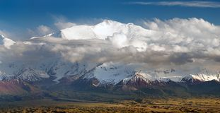 Evening view of Lenin Peak from Alay range. Kyrgyz Pamir Mountains - Kyrgyzstan and Tajikistan border- Central Asia Roof of the World Royalty Free Stock Images