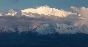 Evening view of Lenin Peak from Alay range. Kyrgyz Pamir Mountains - Kyrgyzstan and Tajikistan border- Central Asia Roof of the World Stock Photography