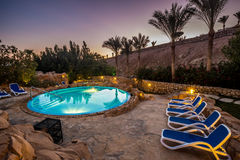 Evening view for luxury swimming pool in night illumination Royalty Free Stock Photography