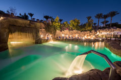 Evening view for luxury swimming pool in night illumination Royalty Free Stock Photo