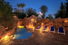 Evening view for luxury swimming pool in night illumination Royalty Free Stock Photos