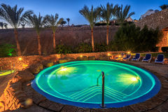 Evening view for luxury swimming pool in night illumination Stock Image