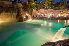 Evening view for luxury swimming pool in night illumination Stock Photography