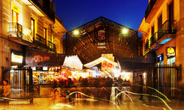 Evening view of main gate at La Boqueria market in Barcelona Stock Images
