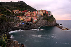 An evening view of Manarola on cliff -- an amazing village in Cinque Terre, Italy Stock Photos