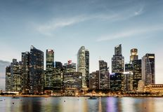 Evening view of Marina Bay and downtown of Singapore. Skyscrapers and other modern buildings are visible on sky background. Singapore is a popular tourist royalty free stock photography