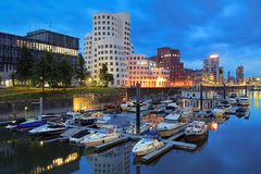 Evening view of Media Harbor with Neuer Zollhof buildings, Dusseldorf Royalty Free Stock Image