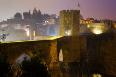 Evening view of medieval bridge over river at Besalu Stock Photo