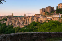 Evening view of Sorano, Tuscany, Italy. Evening view of the medieval town Sorano, Tuscany, Italy Royalty Free Stock Image