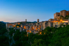Evening view of Sorano, Tuscany, Italy. Evening view of the medieval town Sorano, Tuscany, Italy Stock Photos