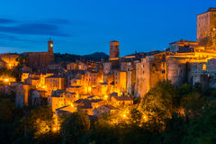 Evening view of Sorano, Tuscany, Italy. Evening view of the medieval town Sorano, Tuscany, Italy Stock Images