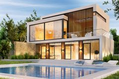 Evening view of a modern large house with swimming pool royalty free stock images