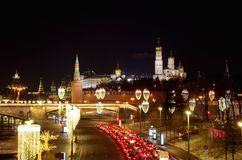 Night view with illumination on the Moscow Kremlin, Moscow, Russia. Evening view of the Moscow Kremlin and Moskvoretskaya embankment with new year illumination royalty free stock image