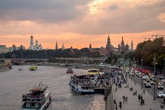 Moscow - September 24, 2018. Evening view of the Moscow Kremlin, Zaryadye park and ships on Moscow river in front of rainy clouds. Evening view of the Moscow stock photos