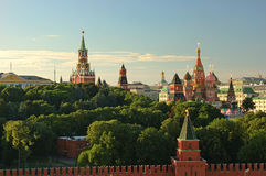 Evening view on Moscow Red Square Kremlin towers red square wall stars and Clock Kuranti Saint Basil Cathedral church. Panorama fr. Om bell tower. Moscow Royalty Free Stock Photo