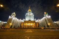 Evening view of the Moscow State University. MOSCOW - MAY 13: Evening view of the Moscow State University with a large number of lamps on May 13, 2013 in Moscow royalty free stock image