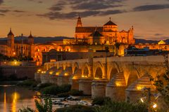 Evening view at the Mosque - Cathedral with Old Roman bridge in Cordoba, Spain royalty free stock photo