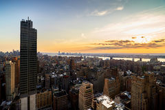Evening view of New York City. Evening view from a high building of Midtown, New York City with Hudson River stock images