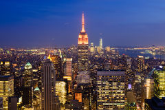Evening view of New York City and Empire State Building, USA. Picture of New York City taken in the evening from the observation deck of the Rockefeller Center stock images
