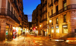 Evening view of old street at Barcelona Stock Photos