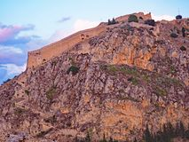 An evening view of Palamidi Castle in Nafplio, Greece. An evening view of the mountaintop Palamidi Fortress in Nafplio, Greece royalty free stock image