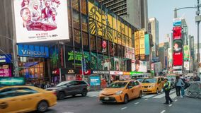 Evening view of pedestrians and traffic at Times Square . 4K time lapse stock video