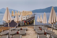 Evening view of the pier with sun loungers Stock Image