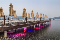 Evening view of the pier with sun loungers Royalty Free Stock Photography