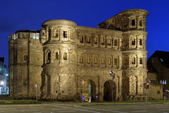 Evening view of the Porta Nigra in Trier, Germany. Evening view of the Porta Nigra (Black Gate) - a 2nd-century Roman city gate in Trier, Germany royalty free stock images