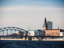 Evening view of quay Daugava rive in Riga. Royalty Free Stock Photo