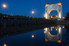 Evening view, with reflection on water arch, to first lock of Volga-Don Canal named after VI Lenina, Volgograd Royalty Free Stock Photo