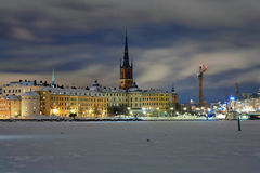 Evening view of Riddarholmen island in Stockholm. Stockholm, evening view of Riddarholmen island and Gamla Stan in winter, Sweden Stock Images